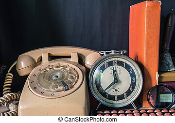 clock and telephone in the room.