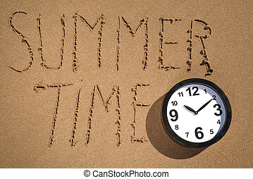 clock and text summer time on the beach