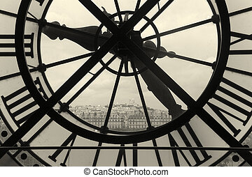 Clock and view of Montmartre, Paris, Ile de France, France