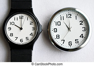 Daylight saving time (DST) - Clock and watche that show the...