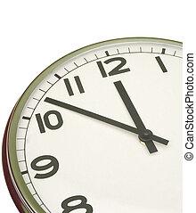 clock at five minutes to twelve