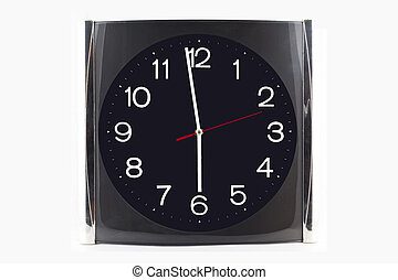 Clock black-grey stainless on the wall and table isolated on white background.