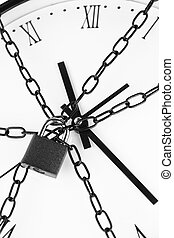 Clock bound with chain and padlock