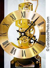 Clock dial - Close up shot of golden clock gears