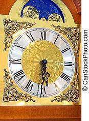 Clock dial - Close up shot of clock dial in gold