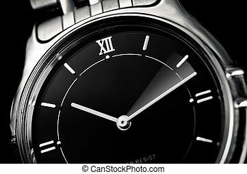 Analog wrist watch closeup, fast time advance concept