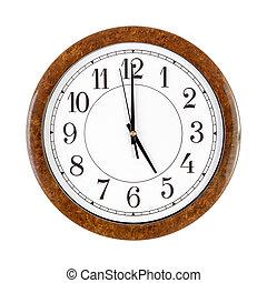 A white clock face showing 5 o'clock