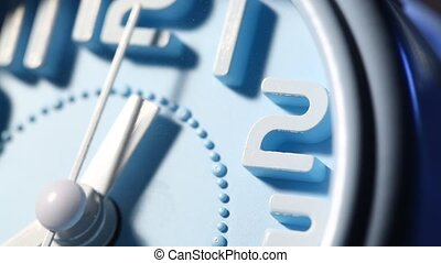 Clock Face Ticking - Close up of a modern analog clock face...
