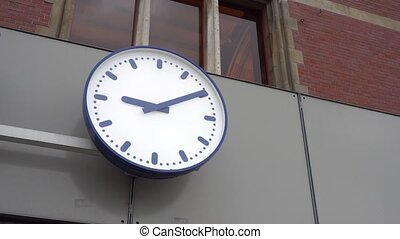 Clock Hanging at the Wall outside