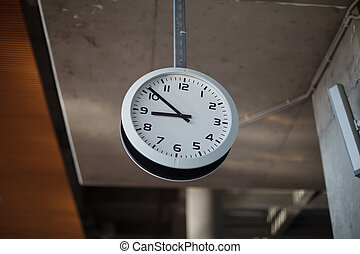 Clock hanging from the ceiling