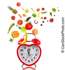 Clock in shape of heart with fruits and vegetables.