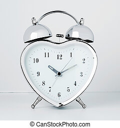 clock in the form of heart on a white background