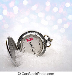 Clock lying in the snow