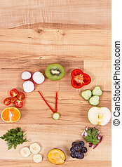 Clock made of fruits and vegetables showing time for healthy eating, place for text