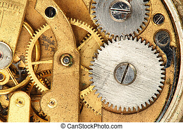 Clock - Mechanism of old clock - sprockets in the system are...