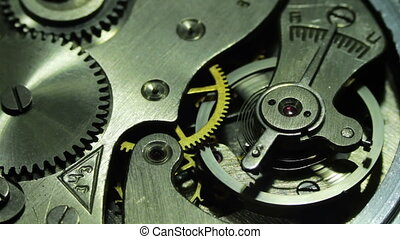 The pendulum sways, the gears are moving dismantled the old clock.