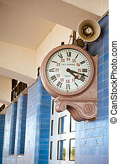 Clock of train station in Portugal with sign Paris and Paul...
