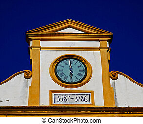 Clock on a church in Seville
