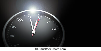 clock on black background - clock with 5 to 12 in focus on...