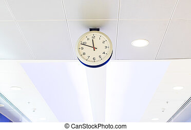clock on ceiling at airport.