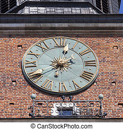 Clock on Hall Tower on Main Market Square , Krakow, Poland