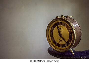 clock on the background of vintage.