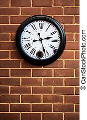 clock on the brick wall