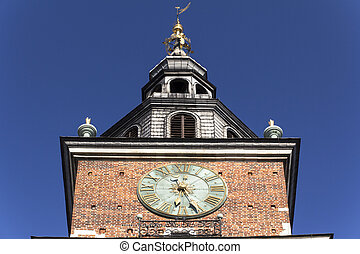 clock on the town hall tower in Cracow, Poland