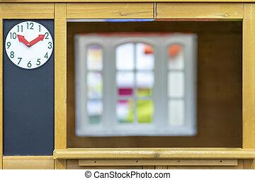 clock on the wall near window