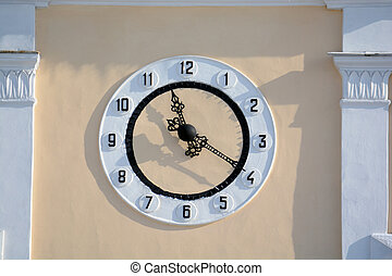 clock on the wall of a building
