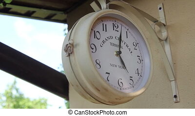 clock on the wall outdoors