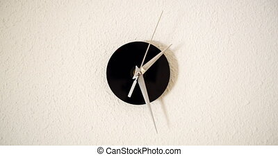 Clock on white background and movement of clock hands. Time lapse clock with three arrow hands moving fast.