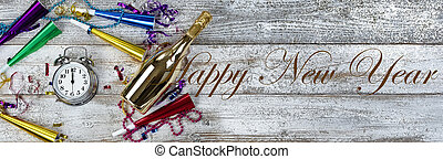 Clock strikes midnight for happy New Year theme with golden champagne and party decorations plus text
