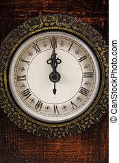 Clock strikes twelve o'clock