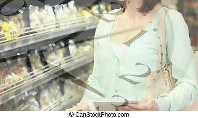 Clock ticking against woman shopping in grocery store - ...