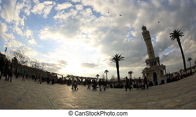 clock tower, beautiful clouds and crowded pedestrian at city...