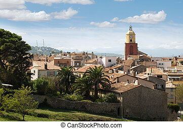 Clock Tower in St Tropez and ancient buildings in the...
