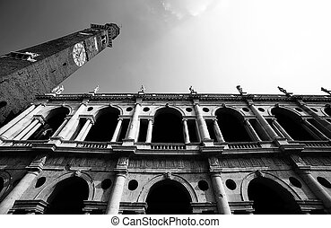 clock tower of the Palladian Basilica in italian city -...