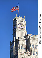 Clock tower on a historic building with USA flag