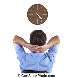 Clock watcher - Office worker watches clock while waiting to...