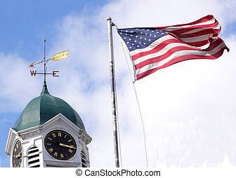 clock weathervane and flag
