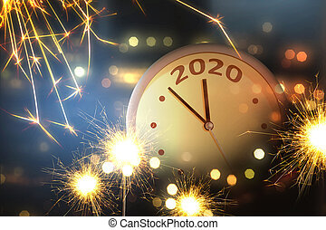 Clock with fireworks background. Happy New Year 2020