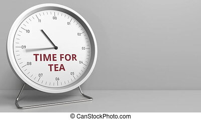Clock with revealing TIME FOR TEA caption. Conceptual...