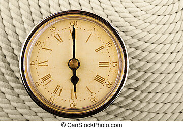 Clock with Roman numerals on cord background. 6