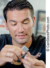 clockmaker repairing wrist watch
