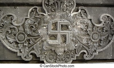 Clockwise Wan Symbol on Ancient Relief Sculpture at Balinese...