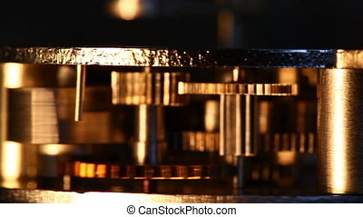 Clockwork mechanism - ?lose up old mechanism on a black ...
