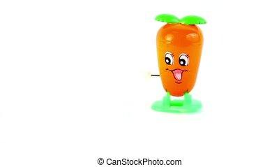 Clockwork orange toy carrot walk, slow down and stop