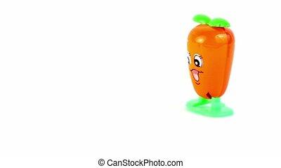 Clockwork orange toy carrot walk, decelerates and stop