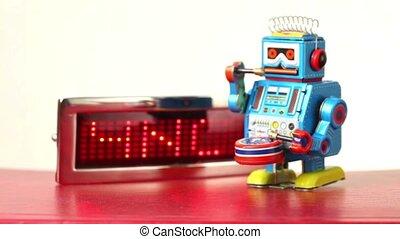 Clockwork robot walks in front of lighting panel